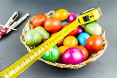 Decorated Easter eggs in a engineer woven basket Stock Images
