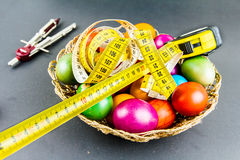 Decorated Easter eggs in a engineer woven basket Royalty Free Stock Photo