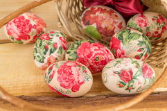 Decorated Easter eggs falling out of basket Royalty Free Stock Images