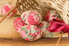 Decorated Easter eggs falling out of basket Stock Image