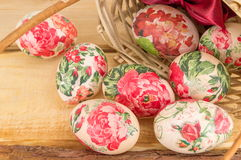 Decorated Easter eggs falling out of basket Stock Photo