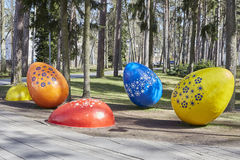Decorated easter eggs in the grass, public area. Extremely big easter eggs. Jurmala, Latvia. 23 april 2016 Royalty Free Stock Photo