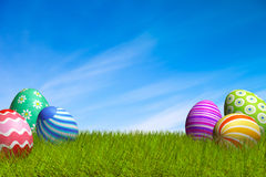 Decorated Easter eggs in the grass under a blue sky Royalty Free Stock Images