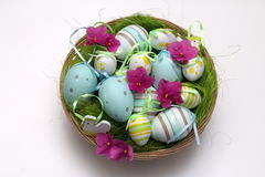 Decorated Easter eggs with pink flowers Stock Photos