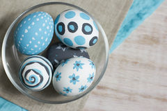 Decorated Easter eggs. The religious Christian holiday Easter is celebrated with eggs. Paint eggs handmade. These are painted with gouache of turquoise and gray Stock Image