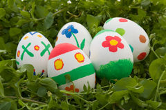 Decorated Easter eggs. Some decorated Easter eggs on the grass Royalty Free Stock Photos