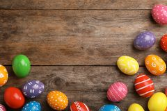 Decorated Easter eggs and space for text on wooden background royalty free stock photography