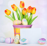 Decorated Easter Eggs and Tulips Stock Images