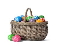Decorated Easter eggs in wicker basket. On white background royalty free stock photo
