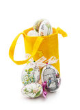 Decorated Easter eggs and yellow basket Royalty Free Stock Photos