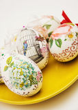 Decorated Easter eggs on the yellow plate Stock Images