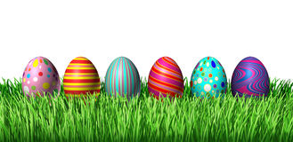 Decorated Eggs. Decorated Easter Egg hunt with painted easter eggs in a row sitting on green grass on a white background as a symbol of spring and a holiday Stock Photos