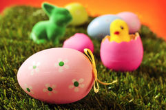 Decorated eggs, easter rabbit and toy chick on the grass Stock Images