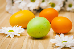 Easter eggs and spring flowers- symbols of Easter Stock Images