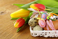 Decorated eggs and spring flowers tulips Stock Photo