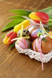 Decorated eggs and spring flowers tulips - symbols of Easter Royalty Free Stock Photography