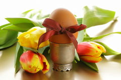 Decorated eggs and spring flowers tulips - symbols of Easter Royalty Free Stock Photo