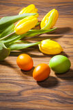 Easter eggs and spring flowers tulips - symbols of Stock Image