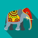 Decorated elephant icon, flat style. Decorated elephant icon in flat style on a blue background Stock Photography