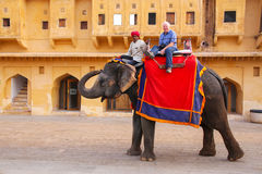 Decorated elephant with tourist walking in Jaleb Chowk main cou. Rtyard in Amber Fort, Rajasthan, India. Elephant rides are popular tourist attraction in Amber Royalty Free Stock Photo
