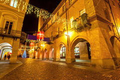 Decorated evening street in Alba, Italy. Stock Images