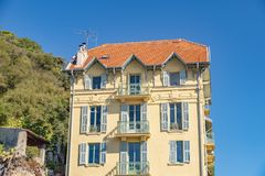 Decorated facade of a historic house in Nice, France. You can see the typical windows, balconies and shutters of a Mediterranean c. View to the decorated facade stock photo