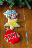 Decorated fancy sugar cookies. On a wood background with garland topper and room for text Stock Image