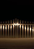 Decorated fence. White picket fence decorated with Christmas lights Royalty Free Stock Photography