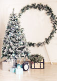 Decorated fir tree and gift boxes in living room.  Royalty Free Stock Photography