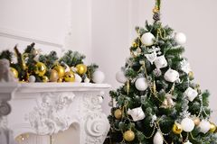 Decorated a fir tree with gifts. New Year Christmas Royalty Free Stock Photos