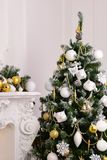 Decorated a fir tree with gifts. New Year Christmas Royalty Free Stock Photo