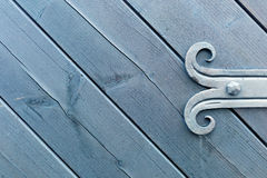 Decorated fitting of wooden door Stock Photos
