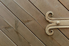 Decorated fitting on wooden door Stock Images