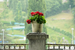 Decorated flower vase with raindrop in backg. Decorated flower vase place on the pillar with raindrop in background Stock Photo