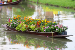 Decorated flowers on a wooden boat Royalty Free Stock Image