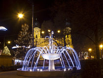 Decorated fountain at christmastime in Debrecen Stock Photo