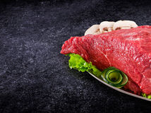 Decorated fresh raw meat - ham with mushrooms and clipping path.  Stock Image