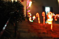 Decorated a front house with color lights, red, green and white. Decorated a front house with color lights, red, green, white, and some green pine leaf wrapped Royalty Free Stock Photography