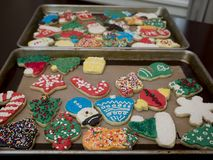 Decorated frosted Christmas cookies. Decorated and multi colored frosted Christmas cookies Stock Image