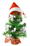Decorated fur-tree with Christmas cap, isolated Stock Photos