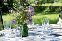 Decorated garden table to eat outside in the early summer Royalty Free Stock Images