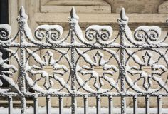 Decorated gate covered with snow stock image