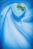 Decorated gift box on blue fabric background holidays concept Stock Images