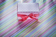 Decorated gift box on striped tablecloth celebrations concept Stock Photos