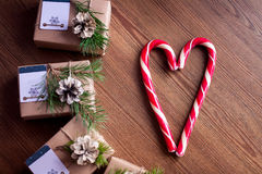 Decorated gift boxes and candies on the wooden background. Royalty Free Stock Image