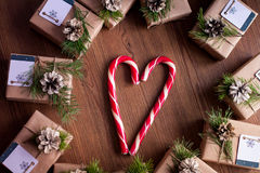 Decorated gift boxes and candies on the wooden background Royalty Free Stock Photography