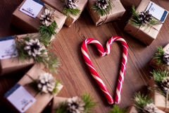 Decorated gift boxes and candies on the wooden background Stock Photo