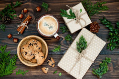 Decorated gift boxes, presents on rustic wooden table. Ideal Christmas morning breakfast. Overhead, flat lay, top view. Stock Photos