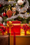 Decorated gift boxes under the Christmas tree Stock Image