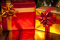 Decorated gift boxes under the Christmas tree Royalty Free Stock Photography
